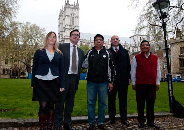 Ecuadorian Indigenous leaders Humberto Piaguaje (middle) and Guillermo Grefa (far right) meet with representatives from the Churh of England's Investment Department and Hermes Fund Managers at Westminster Abbey in London.