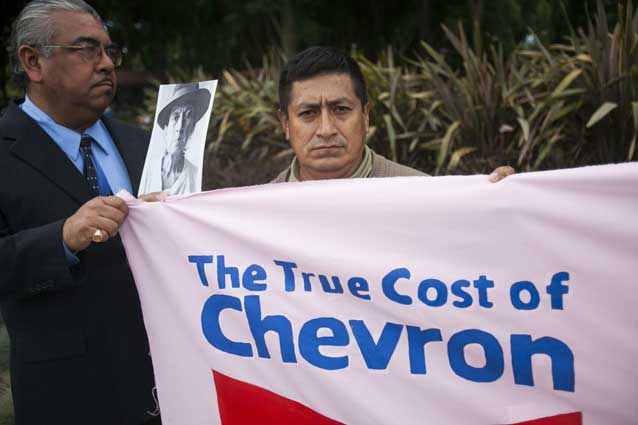 Servio Curipoma protesting at Chevron's AGM